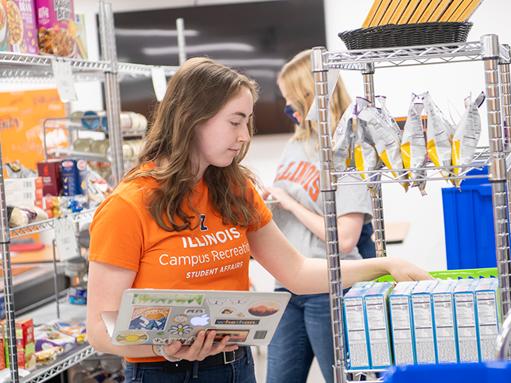 Students stock shelves in a grocery store.