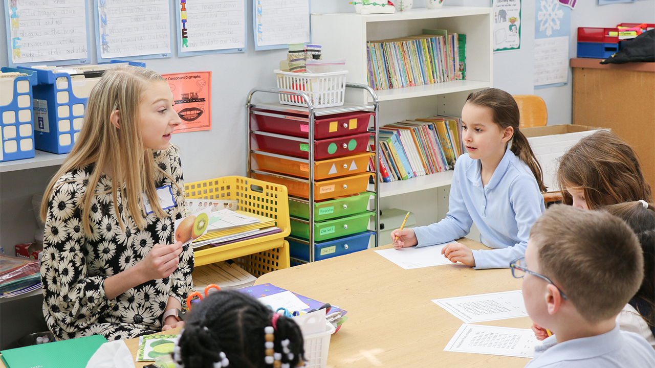 Dietetics student working with children in a classroom.