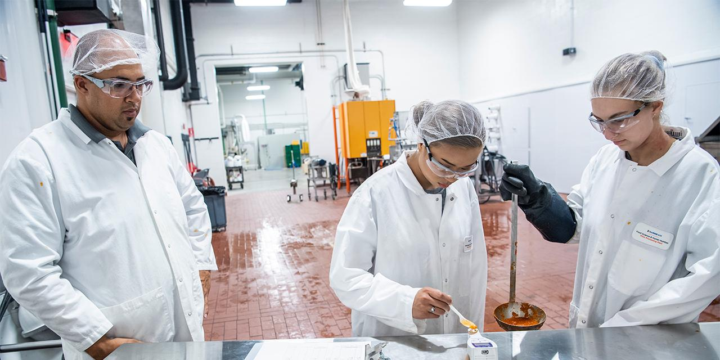 Undergraduate students working in lab.